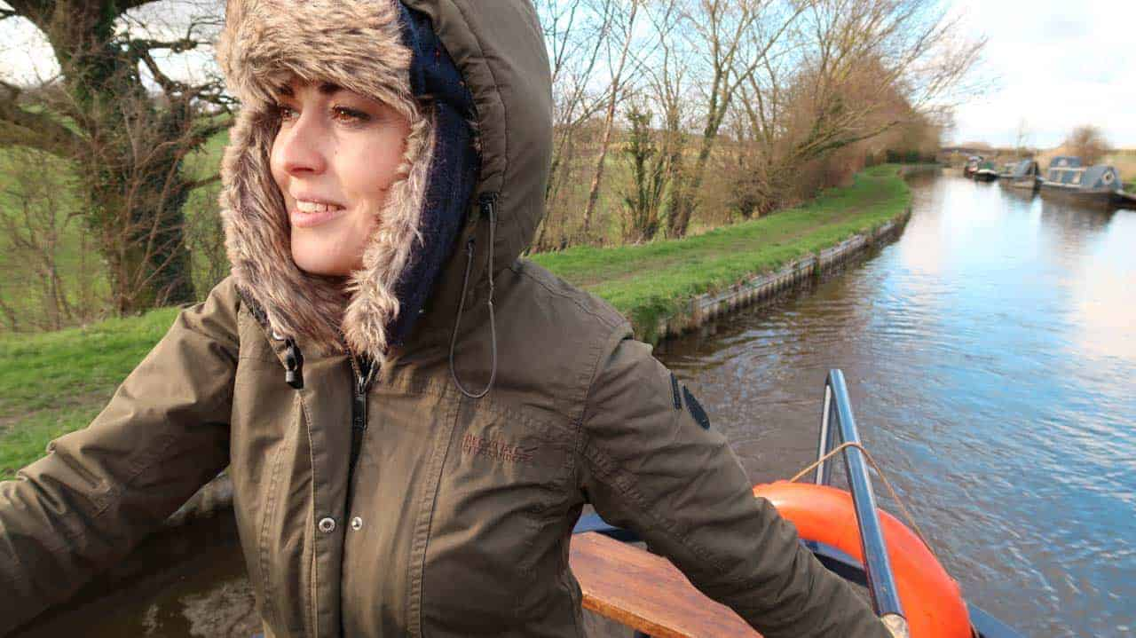woman narrowboating in cold