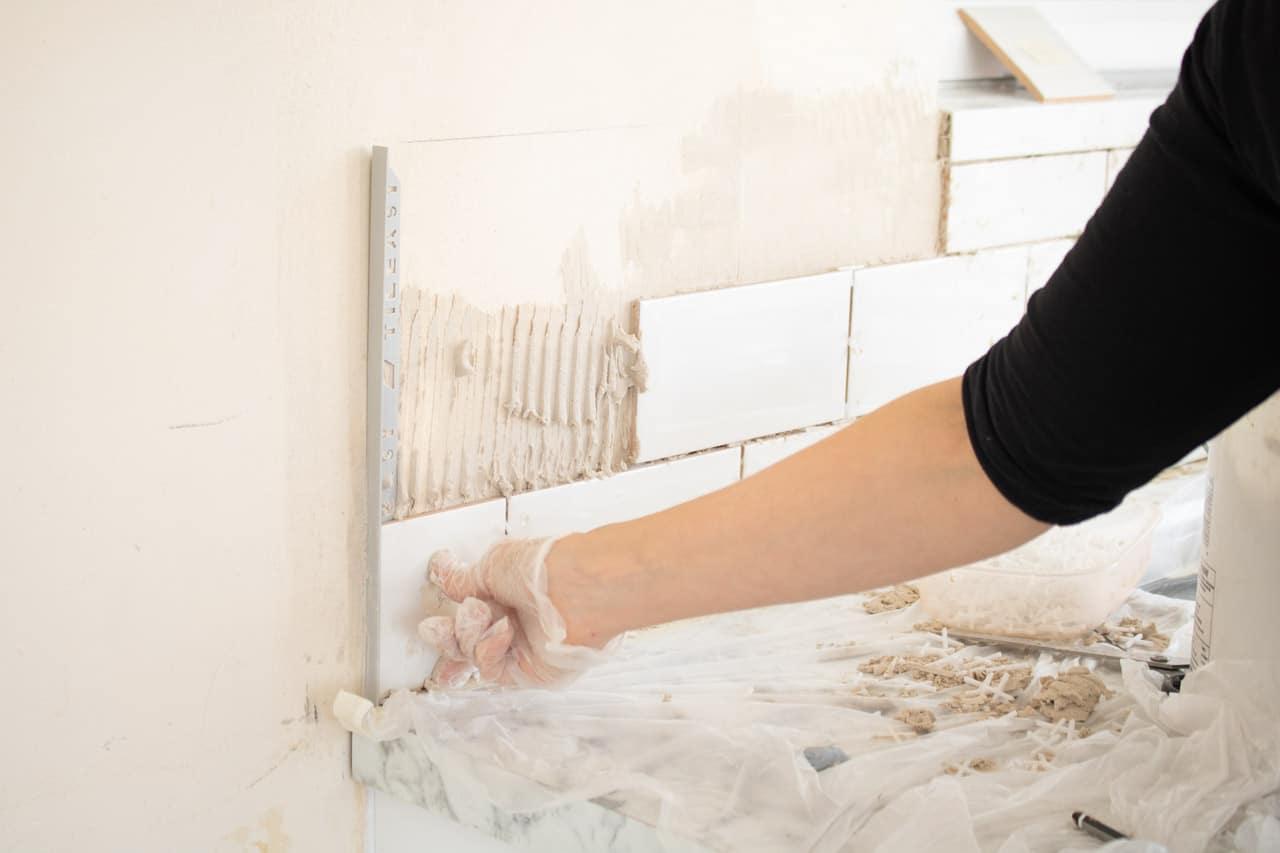 installing grey straight edge tile trim