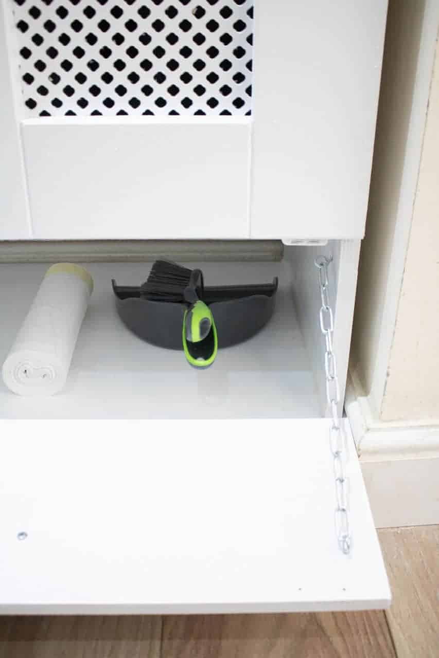 drop down drawer cover with chain for bin liners underneath recycling bins cupboard