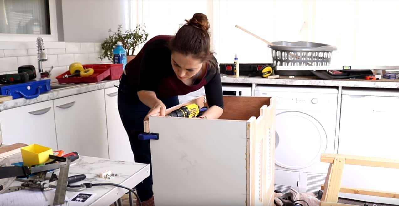 woman fixing back strip for hinge lid