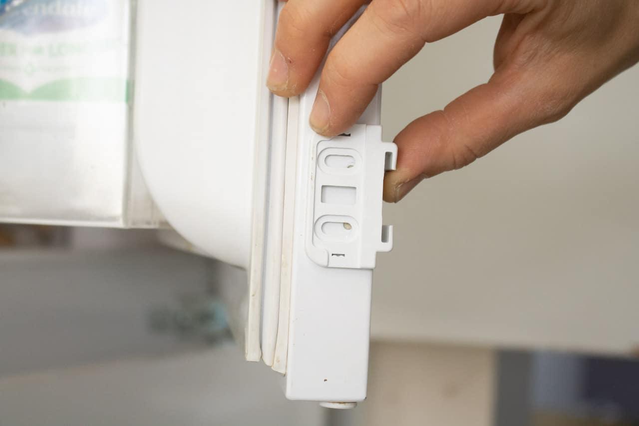 L shape bracket on fridge end door