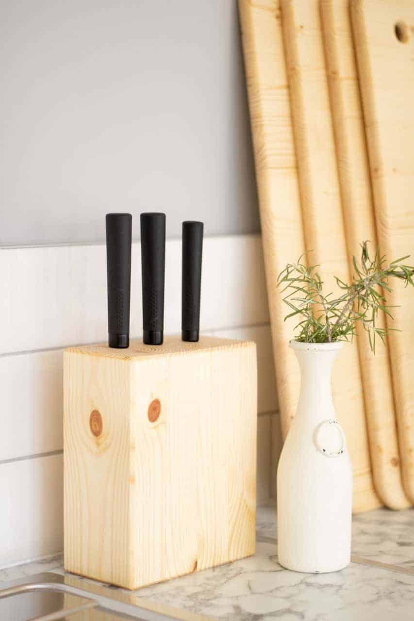 knife block set made of pine on kitchen worktop