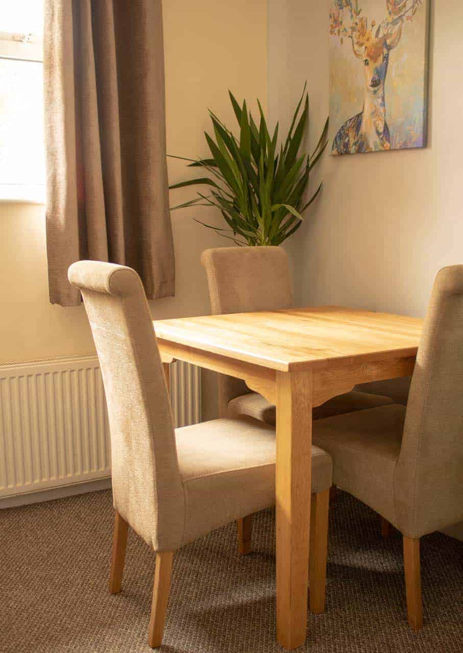 Restored oak dining table with chairs to match