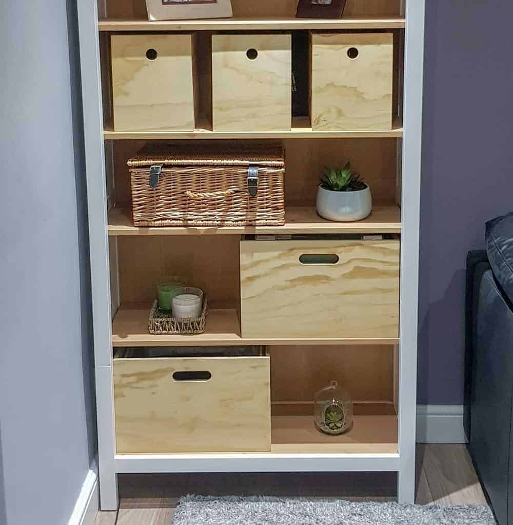 hygge style book case with plants, plywood storage boxes and foolscap suspension box files.