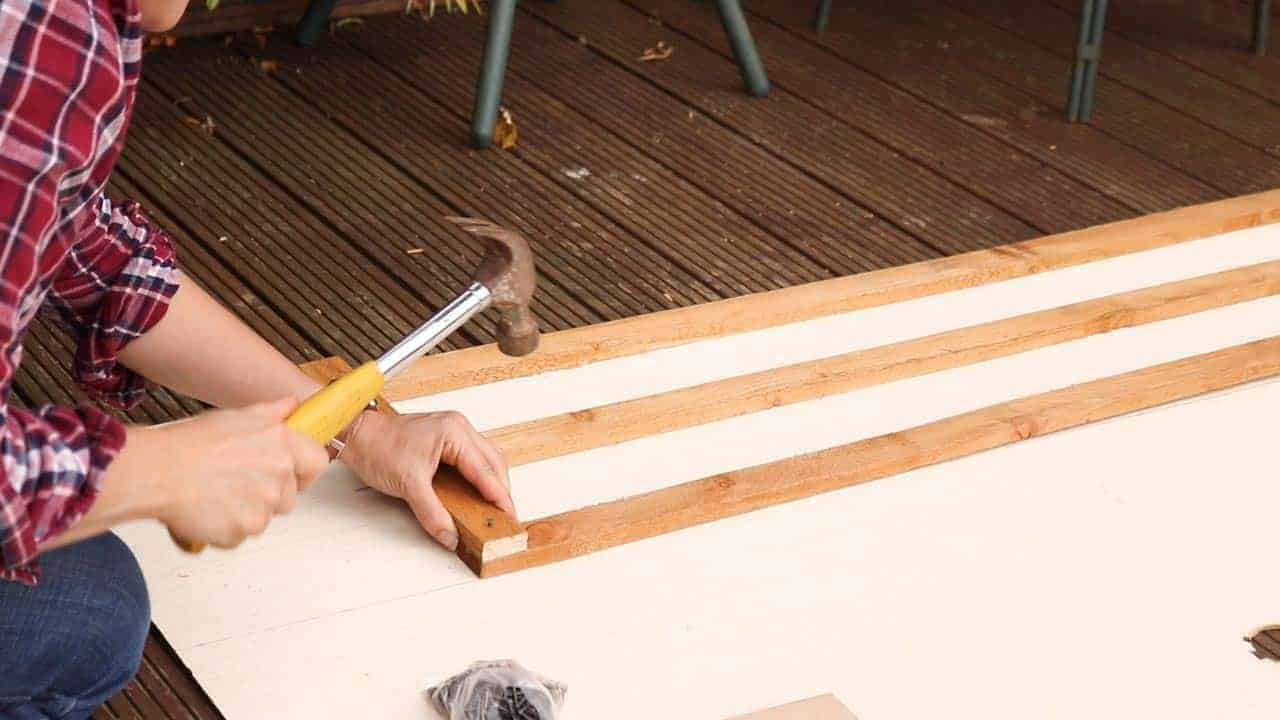 hammering rectangular wooden trellis together