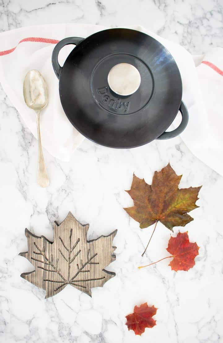 maple leaf trivet with cast iron pan